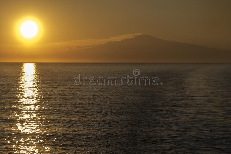 Mount Etna Sunset. Mount Etna is an active stratovolcano on the east coast of Sicily, Italy, in the Metropolitan City of Catania, between the cities of Messina stock images