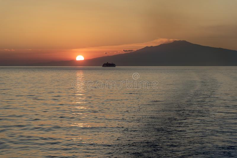Mount Etna Sunset. Mount Etna is an active stratovolcano on the east coast of Sicily, Italy, in the Metropolitan City of Catania, between the cities of Messina royalty free stock image