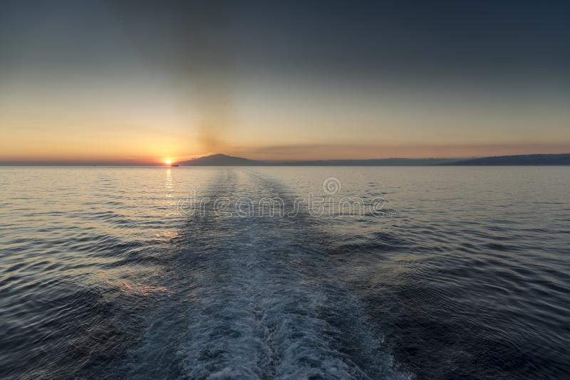 Mount Etna Sunset. The ship near the mountain is The Jewel of the Seas Mount Etna is an active stratovolcano on the east coast of Sicily, Italy, in the royalty free stock images