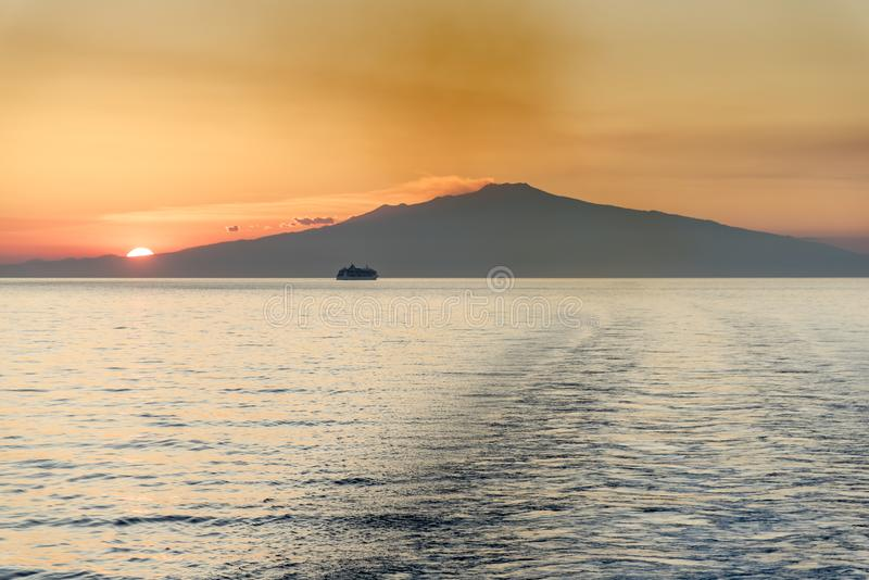 Mount Etna Sunset Sicily. Mount Etna Sunset. The ship is The Jewel of the Seas Mount Etna is an active stratovolcano on the east coast of Sicily, Italy, in the stock photography