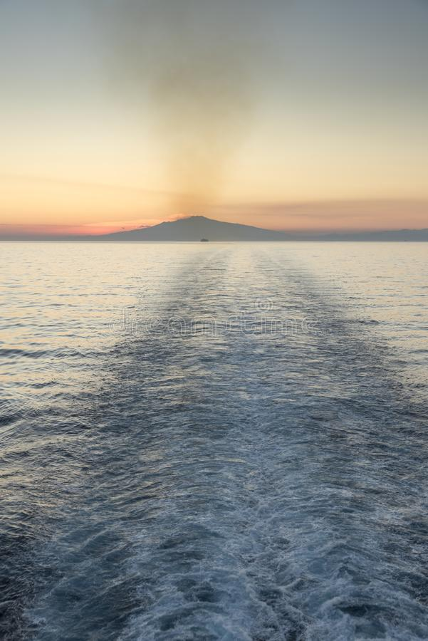 Mount Etna Sunset Sicily. Mount Etna Sunset. The ship is The Jewel of the Seas Mount Etna is an active stratovolcano on the east coast of Sicily, Italy, in the royalty free stock image