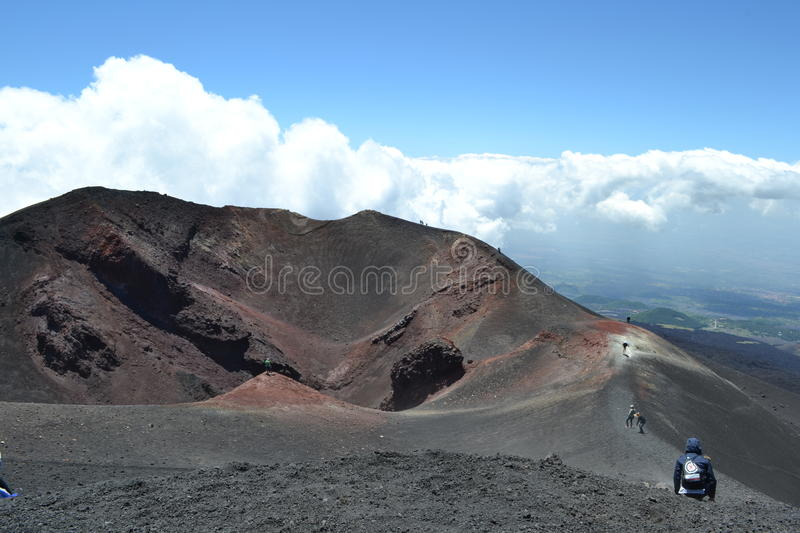 Mount Etna. Tourists walking at the top of mount Etna in Sicily royalty free stock photo