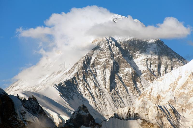 Mount Everest with beautiful clouds on the top. Evening panoramic view of mount Everest with beautiful clouds on the top from Gokyo Ri - Everest area, Sagarmatha royalty free stock photos