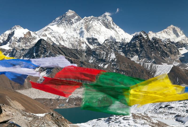 Mount Everest with buddhist prayer flags. View of Mount Everest, Lhotse and Makalu with buddhist prayer flags from Renjo La pass - Nepal royalty free stock photos