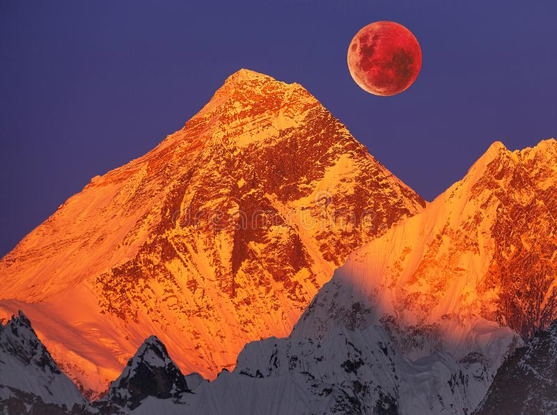 Mount Everest Sunset Full Moon. Majesty of nature: golden pyramid of Mount Everest 8,848 m at sunset on a full moon royalty free stock photo