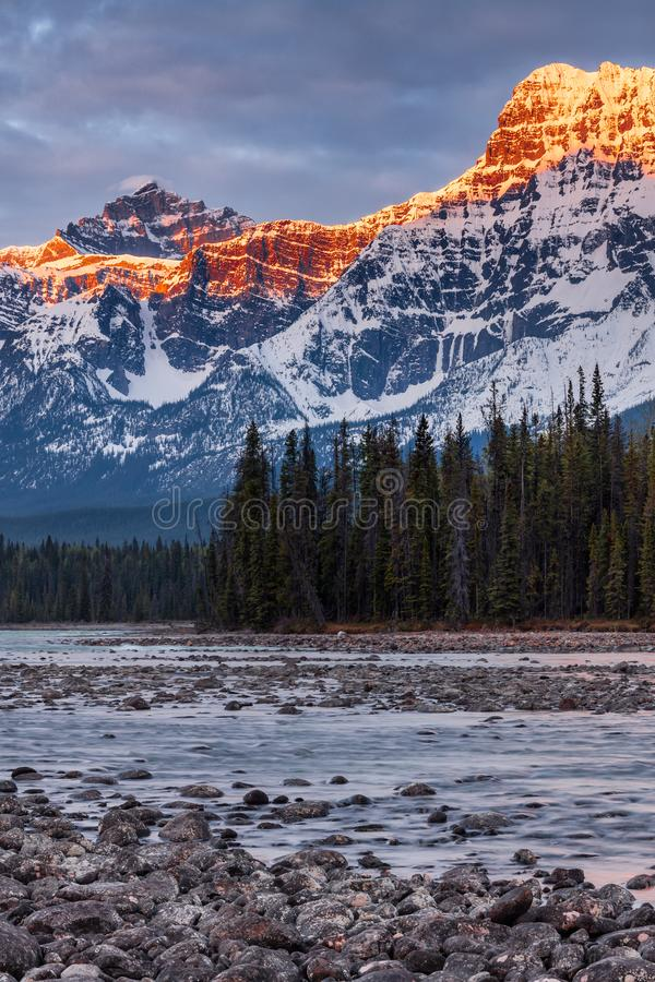 Mount Fryatt and Whirlpool Peak with the Athabasca River at sunrise stock photos