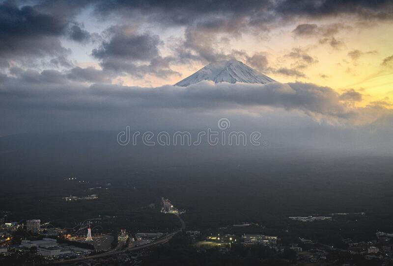 Mount Fuji in in the clouds at Sunset. Mount Fuji in in the clouds and the city under mountain at Sunset, taken on Autumn of 2019 stock photos