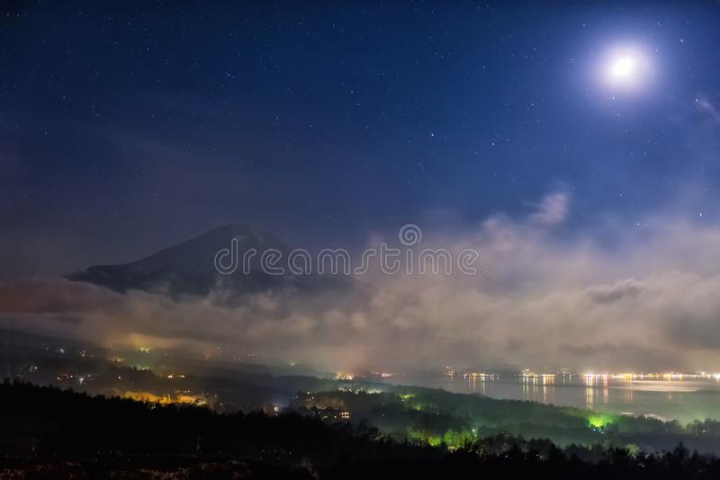 Mount Fuji with full moon and mist stock image