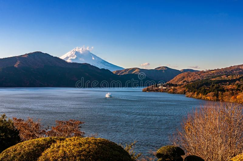 Mount Fuji, Lake Ashi and Hakone town with touristic boat cruising royalty free stock images