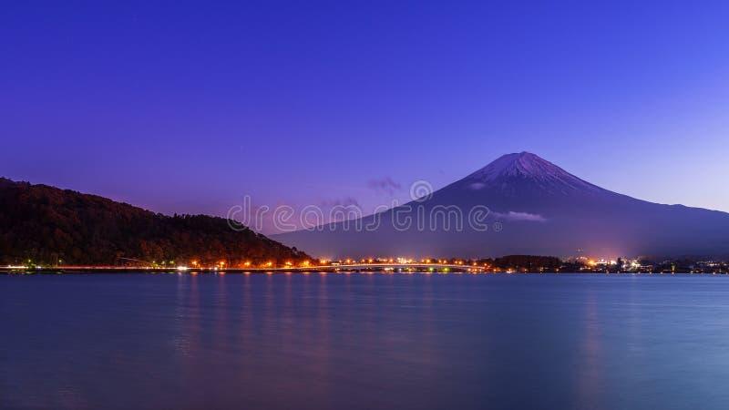 Mount fuji at lake kawaguchiko in early night stock photography