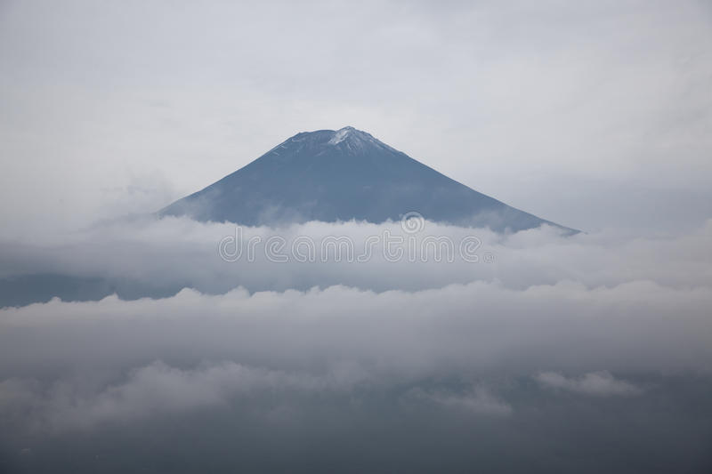 Mount Fuji summit over the clouds, Japan stock photography