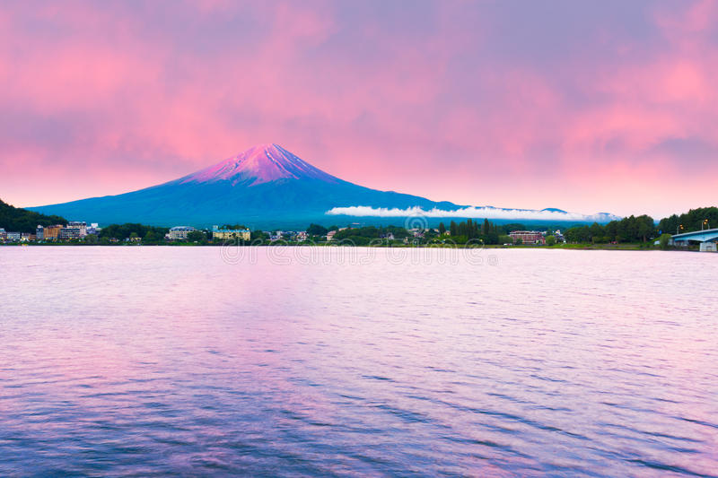 Mount Fuji Sunrise Lake Kawaguchi Water Red Sky. Fiery colorful sky above the red crater cone of Mount Fuji at dawn sunrise over Lake Kawaguchiko water on a stock image