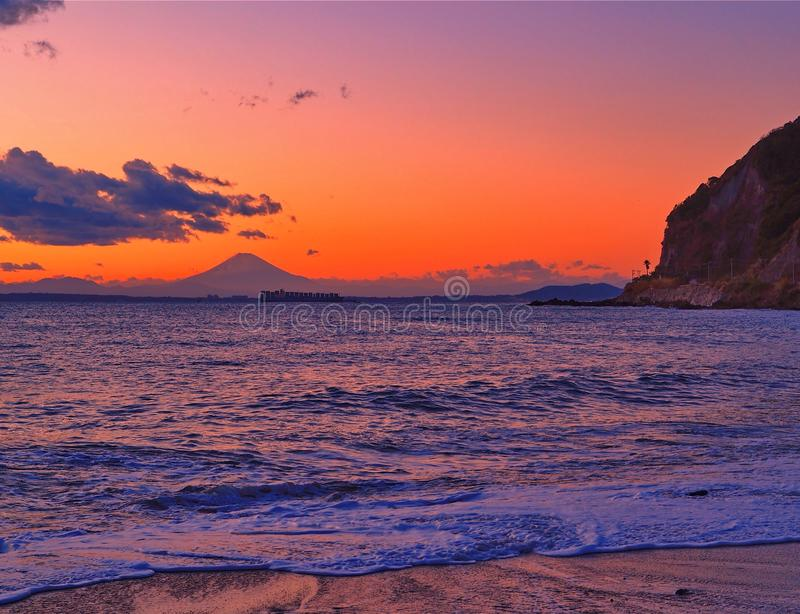 Mount Fuji at sunset with coastline and beach royalty free stock photography