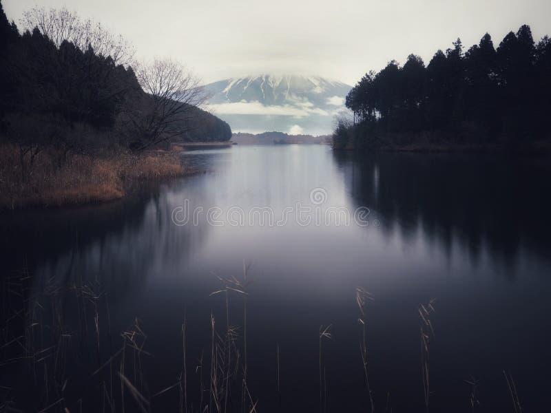 Mount Fuji at Tanuki lake. Lake Tanuki 田貫湖 Tanuki-ko is a lake near Mount Fuji, Japan. It is located in Fujinomiya, Shizuoka Prefecture, and is royalty free stock images