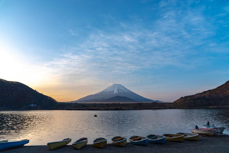 Mount Fuji. view at Lake Shoji  Shojiko  in the morning day with row of boats. Mt. Fuji reflection on sunrise. Fuji Five Lake region, Yamanashi prefecture stock photo