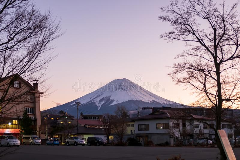 Mount Fuji and the village which is in front of the mountain and the evening light. The Mount Fuji and the village which is in front of the mountain and the stock photo