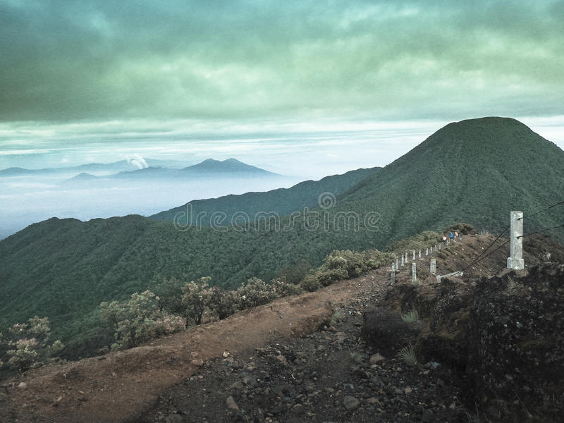 Mount Gede. Or Gunung Gede is a stratovolcano in West Java, Indonesia. The volcano contains two peaks with  as one peak and Mount Pangrango for the other one