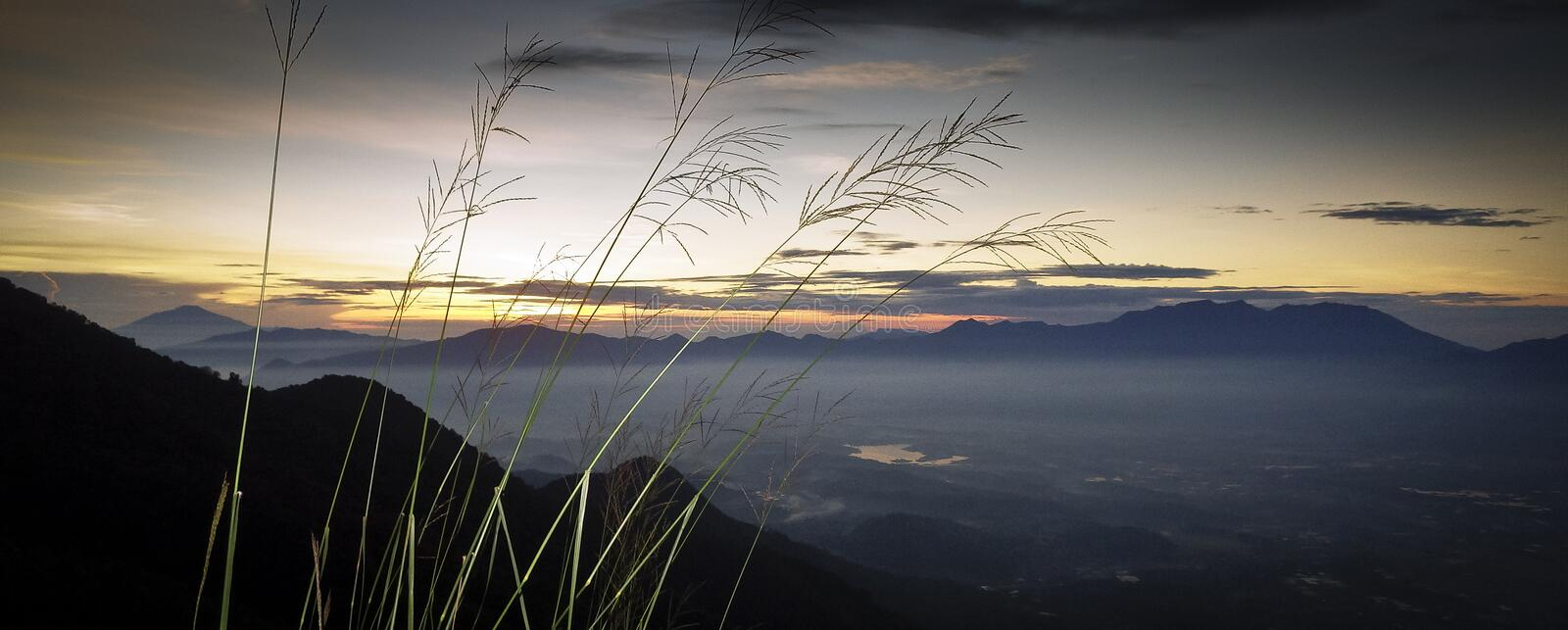 Mount Guntur sunrise. Mount Guntur or Gunung Guntur is an active stratovolcano in western Java. It is part of a complex of several overlapping stratovolcanoes stock photography