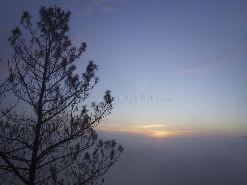 Mount Guntur sunrise. Mount Guntur or Gunung Guntur is an active stratovolcano in western Java. It is part of a complex of several overlapping stratovolcanoes royalty free stock image