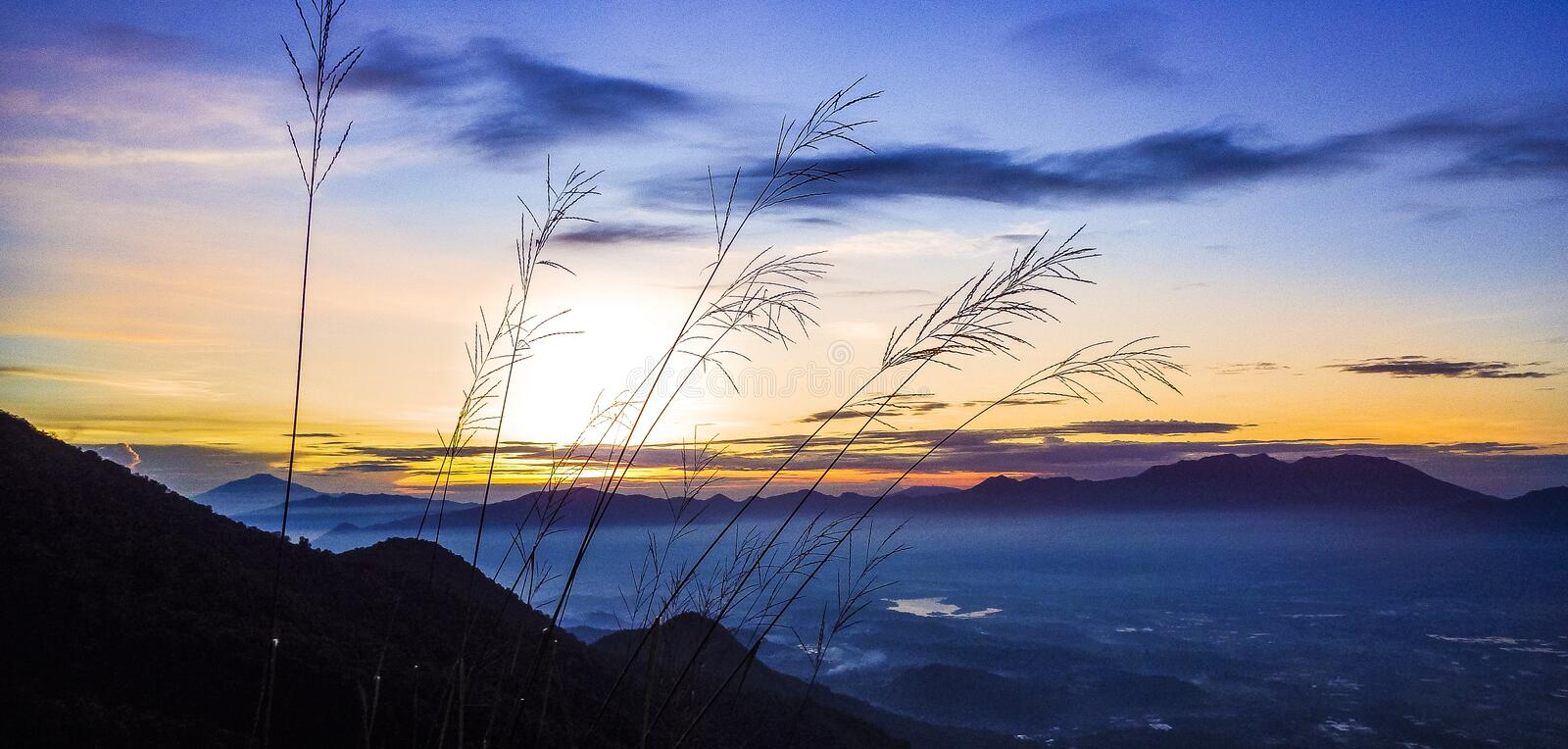 Mount Guntur sunrise. Mount Guntur or Gunung Guntur is an active stratovolcano in western Java. It is part of a complex of several overlapping stratovolcanoes royalty free stock photo