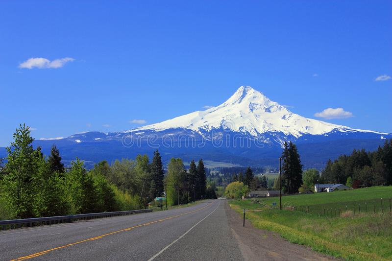 Mount Hood from Highway 35 near Hood River, Oregon, Pacific Northwest, USA. Mount Hood towering over the agricultural landscape near Hood River in the Cascades stock images