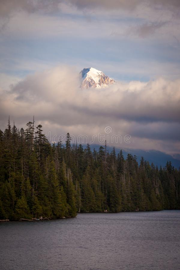 Mount Hood shrouded in low clouds at Lost Lake in Oregon stock photos