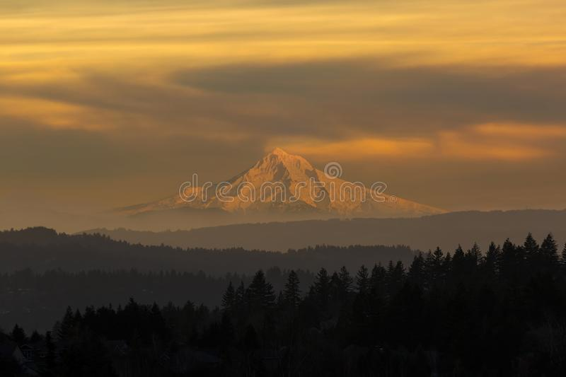 Mount Hood View during Hazy Sunset. Mount Hood view from Happy Valley Oregon during a hazy sunset day in winter season royalty free stock photos