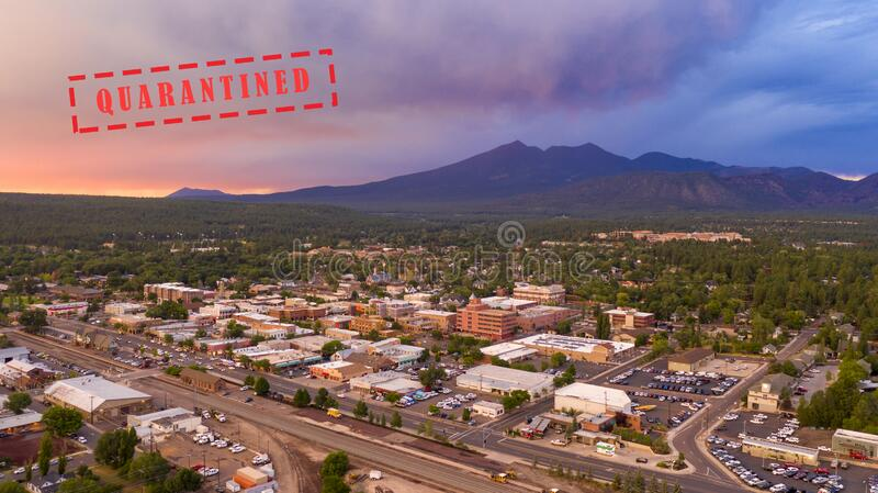 Mount Humphreys at sunset overlooks the area around Flagstaff Arizona. Blue and Orange color swirls around in the clouds at sunset over Flagstaff Arizona stock images