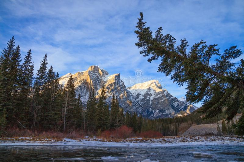 Mount Kidd, a mountain in Kananaskis in the Canadian Rocky Mountains, Alberta and the Kananaskis River in winter stock photos