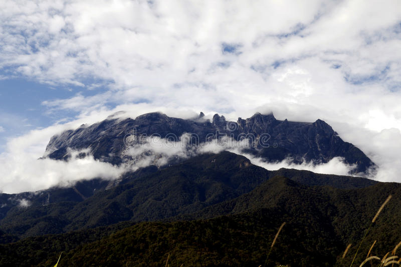 Mount Kinabalu. Or Gunung Kinabalu, Southeast Asias highest peak, towers 13,455 feet above sea level and offers climbers outstanding views of Sabah, Malaysia royalty free stock image