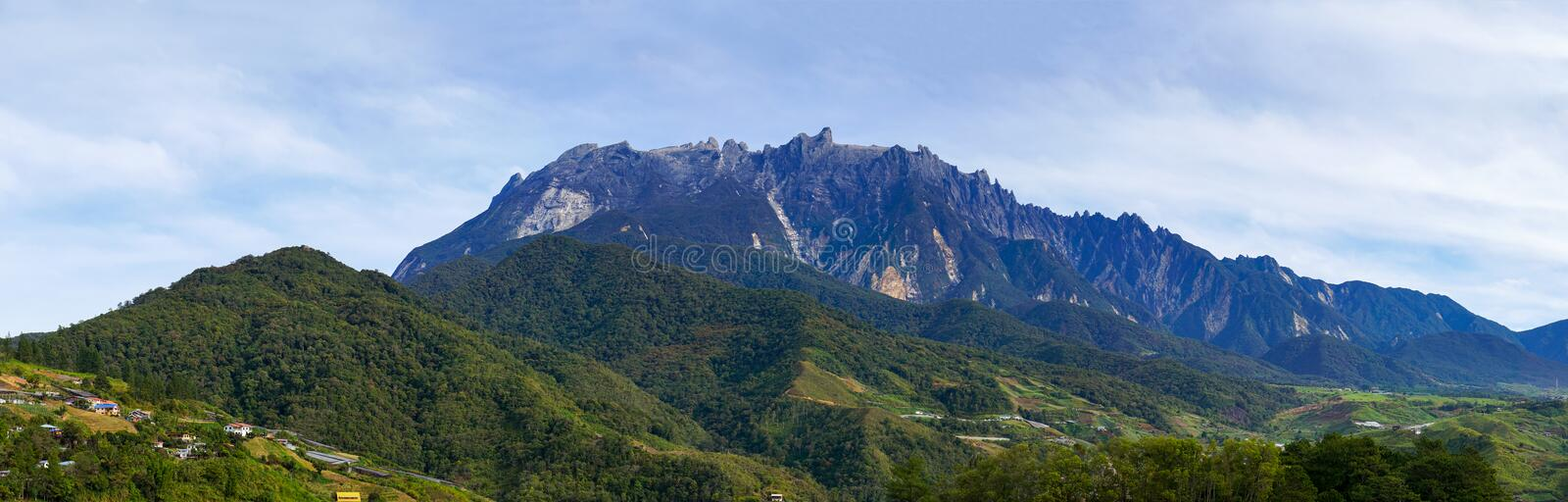 Mount Kinabalu and upper part of Kundasang panorama morning shot. Mount Kinabalu and upper part of Kundasang, including the famous Desa Cattle dairy farm and stock images