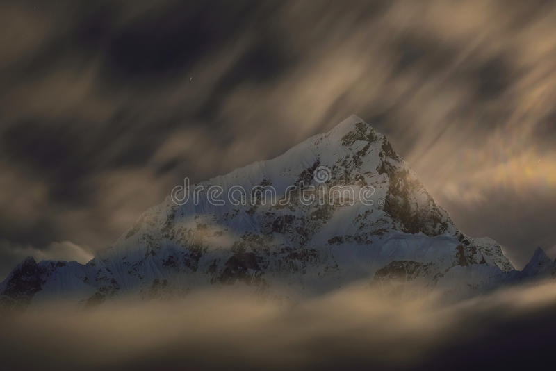 Mount Lhotse by night. Long time exposure with star trails and blurry clouds. Nepal stock images