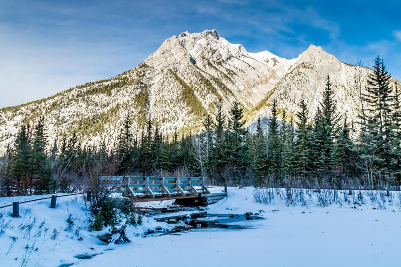 Mount Lorrett Ponds, Bow Valley Wilderness Area Area, Alberta, Canada. Mount lorrett as seen from the ponds with ice melting near the bridge royalty free stock images