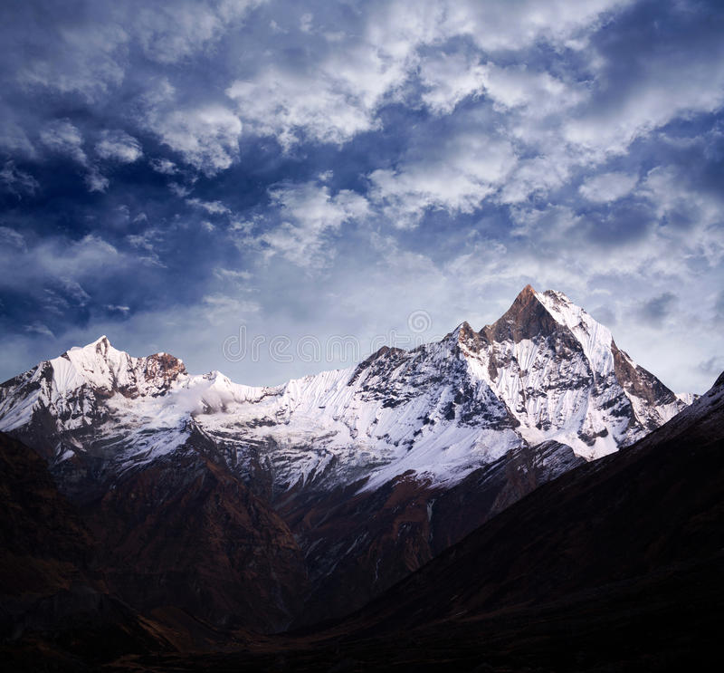 Mount Machapuchare & x28;Fishtail& x29;, view from Annapurna Base Camp, Ne. Panorama of Mount Machapuchare & x28;Fishtail& x29; at twilight, view from Annapurna royalty free stock photography