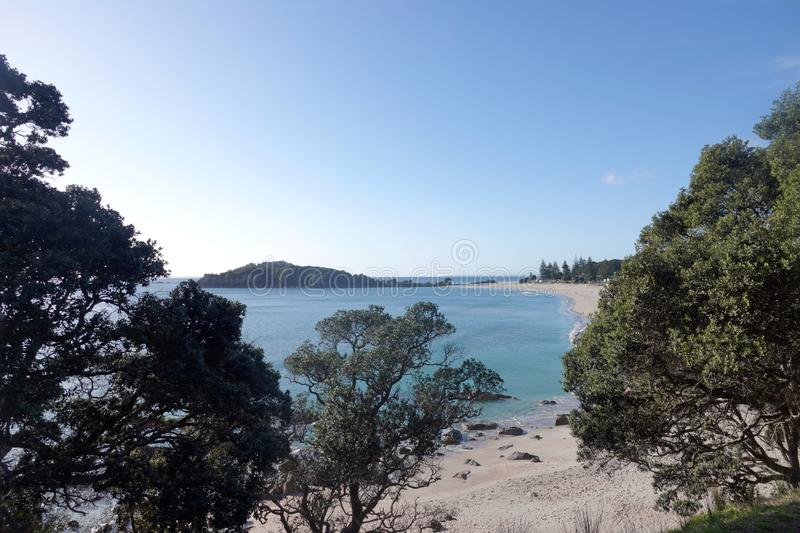 Mount Maunganui beach in Tauranga, New Zealand. From the base of Mount Maunganui, a white sand surf beach stretches as far as the eye can see on a peninsula at royalty free stock photos