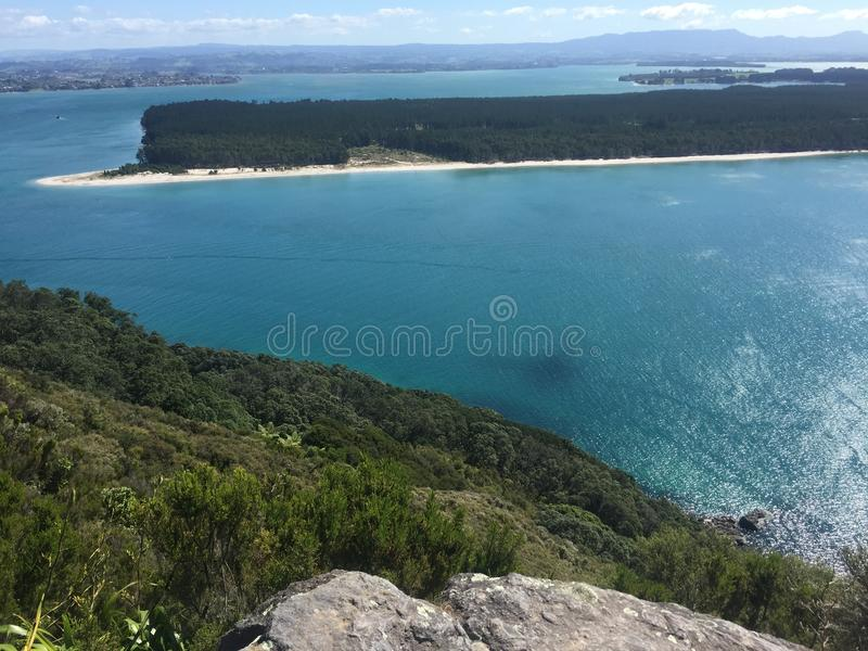 Mount Maunganui. `The Mount` is the colloquial name for Mount Maunganui, a relaxed beach town that occupies a peninsula at the southern end of Tauranga Harbour stock image