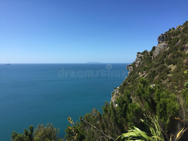 Mount Maunganui. `The Mount` is the colloquial name for Mount Maunganui, a relaxed beach town that occupies a peninsula at the southern end of Tauranga Harbour royalty free stock photos
