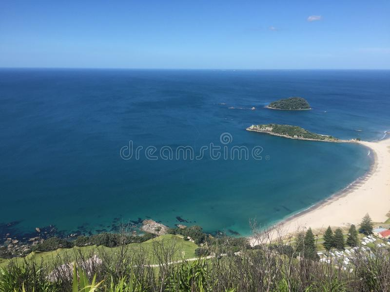 Mount Maunganui. `The Mount` is the colloquial name for Mount Maunganui, a relaxed beach town that occupies a peninsula at the southern end of Tauranga Harbour stock images