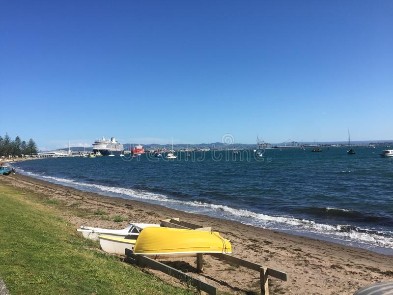 Mount Maunganui. `The Mount` is the colloquial name for Mount Maunganui, a relaxed beach town that occupies a peninsula at the southern end of Tauranga Harbour royalty free stock photography