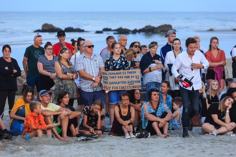 Beach vigil for victims of Christchurch terror attacks, New Zealand. Mount Maunganui, New Zealand, March 16 2019. People have gathered on the Mount Maunganui`s royalty free stock photos
