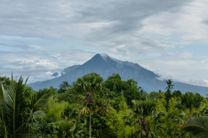 A view of Mount Merapi, Jogjakarta, Indonesia. Mount Merapi, Gunung Merapi, is an active stratovolcano located on the border between Central Java and Yogyakarta stock images