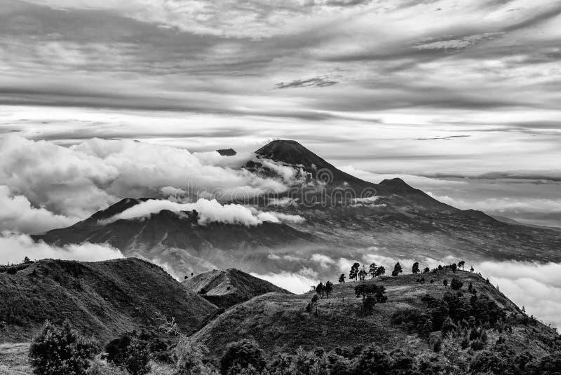 Mount Merapi and Merbabu in the background taken from mount Prau, Jogjakarta, Indonesia in black and white. stock photo