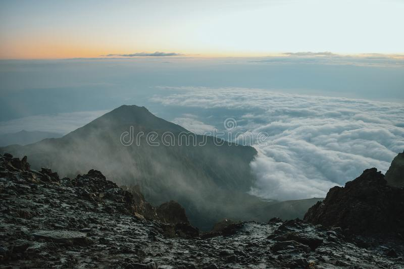 Mount Meru in Arusha National Park, Tanzania. Mount Meru above the clouds, Arusha National Park, Tanzania stock images