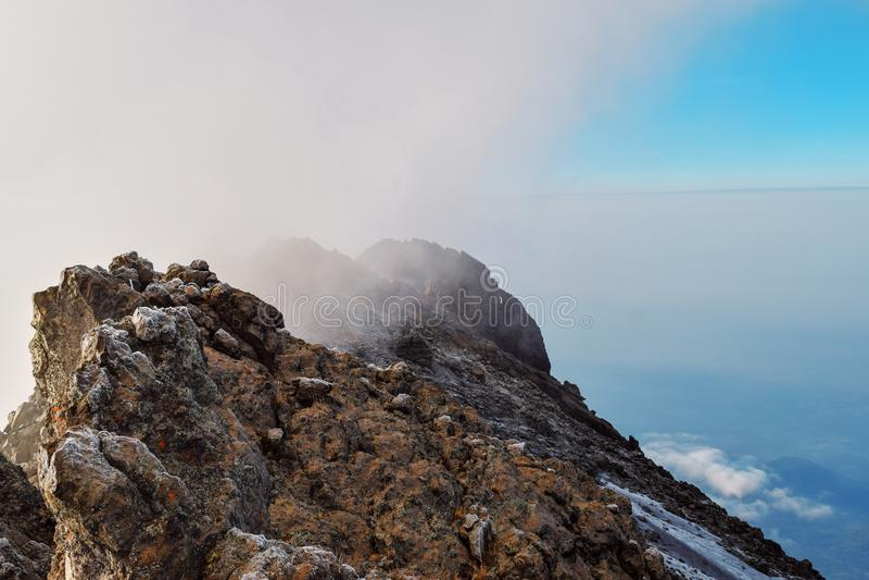 Mount Meru in Arusha National Park, Tanzania. Mount Meru above the clouds, Arusha National Park, Tanzania stock photos