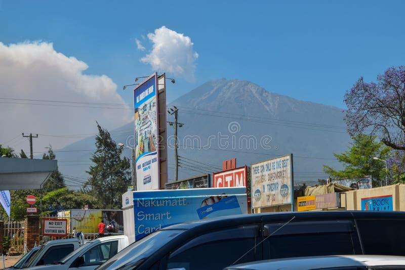 Mount Meru seen from Arusha Town, Tanzania. Mount Meru against a blue sky seen from Arusha Town, Tanzania royalty free stock photography