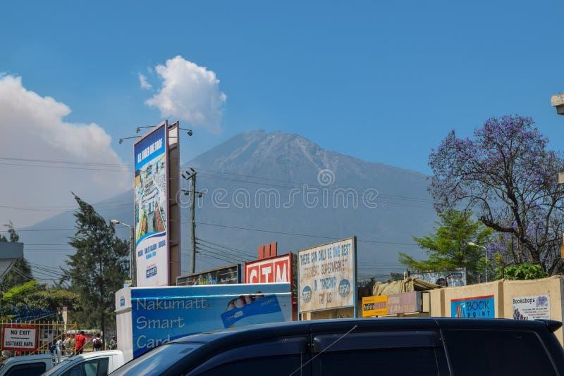 Mount Meru seen from Arusha Town, Tanzania. Mount Meru against a blue sky seen from Arusha Town, Tanzania royalty free stock photo
