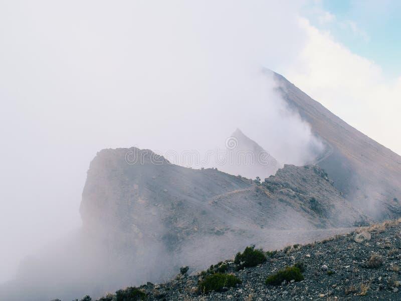 Mount Meru in Arusha National Park, Tanzania. Mount Meru above the clouds, Arusha National Park, Tanzania royalty free stock image