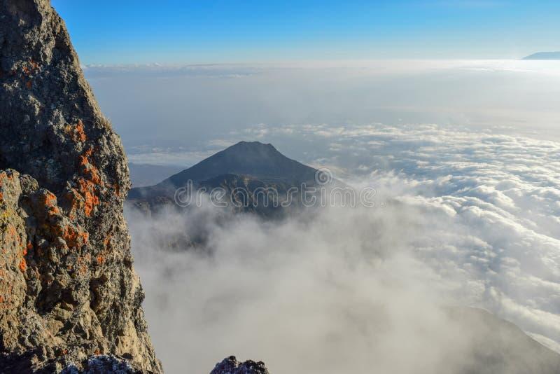 Mount Meru in Arusha National Park, Tanzania. Above the clouds at Mount Meru in Arusha National Park, Tanzania stock photography