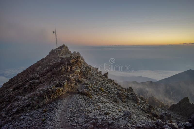 Sunrise above the clouds at Mount Meru, Arusha National Park, Tanzania. Mount Meru, Arusha National Park, Tanzania royalty free stock photo