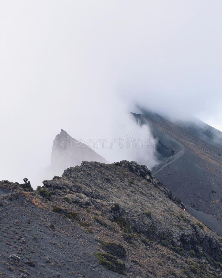 Mount Meru. The summit of Mount Meru, Arusha National Park partly covered by clouds royalty free stock photos